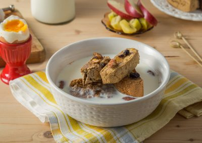Family Farms breakfast with Astarti whole grain wheat rusks with raisins and milk in a bowl